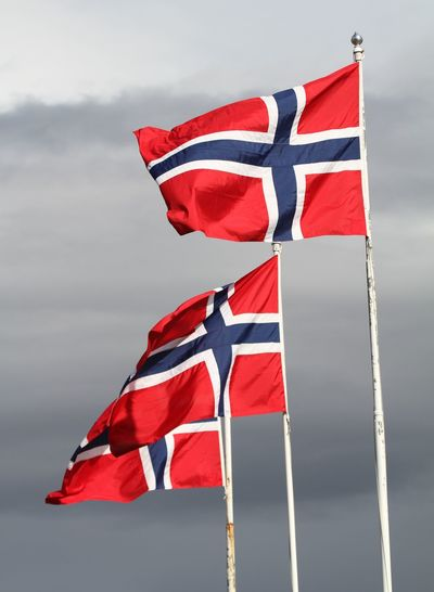 Patriotism Flag Sky Red National Icon Independence Waving Outdoors No People Wind Low Angle View Nature Freedom Pride Pole Norwegian Flag Three Flags