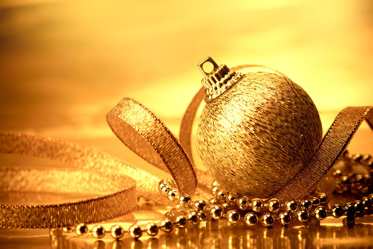 the golden christmas ball decorations for celebration background Celebration Close-up Cloud - Sky Decoration Focus On Foreground Gold Gold Colored Indoors  Jewelry Luxury Metal Nature Necklace No People Ornate Personal Accessory Reflection Shiny Sky Sphere Still Life Sunset