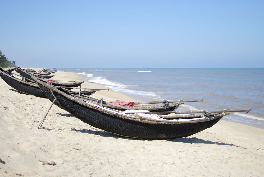 On the beach in Hue, Vietnam Beach Beauty In Nature Blue Boat Clear Sky Day Horizon Over Water Hue, Vietnam Huế Mode Of Transport Moored Nature Nautical Vessel No People Outdoors Sand Scenics Sea Seascape Shore Tranquil Scene Tranquility Transportation Vietnam Water