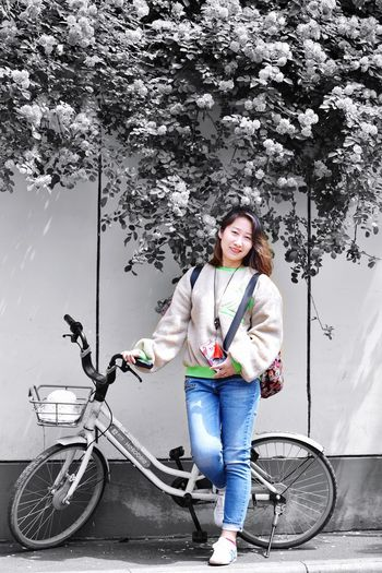 Transportation Bicycle One Person Full Length Real People Casual Clothing Smiling Happiness Looking At Camera Front View Portrait Mode Of Transportation Lifestyles Day Leisure Activity Emotion Standing Young Adult Nature Outdoors