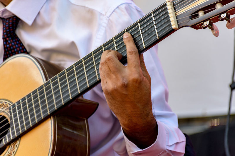 Acoustic guitar player with her instrument detail in a live presentation Brazil Live Music Music Sound Wood Acoustic Guitar Art Brazilian Cavaquinho Chorinho Culture Detail Finguer Guitar Hand Men Musical Musical Instrument Musical Instrument String Musician Musicians Outdoors Party Player String Instrument