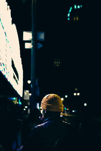 Man in Yellow Beanie stands in front of marquee sign in Downtown LA Adult Adults Only Beanie City City City Life Downtown Los Angeles DTLA Illuminated Night Nightlife One Person Outdoors People Rear View