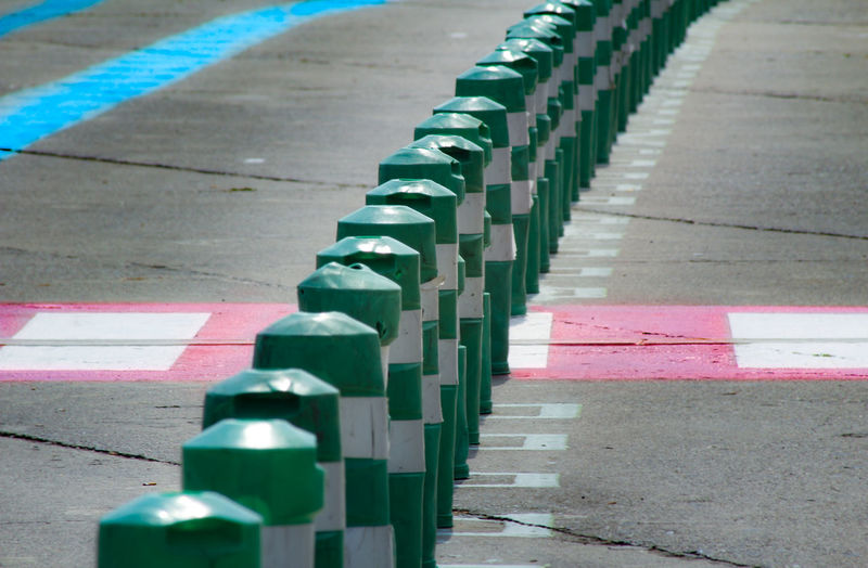 Green Sign Day In A Row No People Outdoors Parking Road Striped Colour Your Horizn