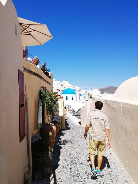 Around Santorini Man Alone On The Road. Alonetime Laneway Santorini Santorini Island Santorini Greece Santorini Scene