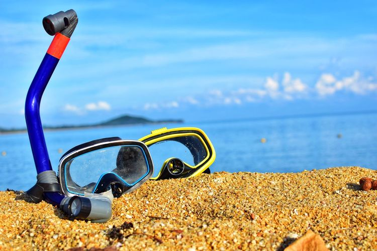 Scuba diving and Snorkeling lying on the sandy beach against the backdrop of the picturesque on sandy texture background and free and Summer holidays swimming concept. Couple Holiday Hot Scuba Diving Sunlight Thailand Tube Vacations Beach Beauty In Nature Close-up Diving Goggles Eyewear Gear Island Nature Outdoors Personal Accessory Sand Sandy Sea Sunlight Travel Destinations Tropical Water