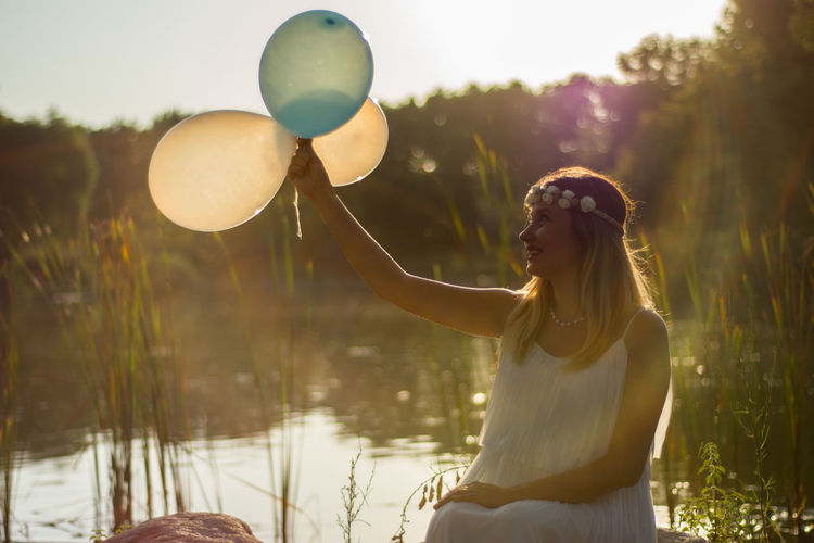 Pregnant Woman Balloon Beautiful Woman Beauty In Nature Blond Hair Botonicalgarden Lake One Person Outdoors Pregnant Pregnant Phtography Real People Water Young Adult Young Women Be. Ready. See The Light