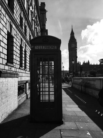 Monochrome Photography Architecture Built Structure Building Exterior Communication Telephone Booth Technology Connection Western Script Culture Old-fashioned City Sky Travel Destinations History City Life Convenience Person Outdoors Office Building The Past