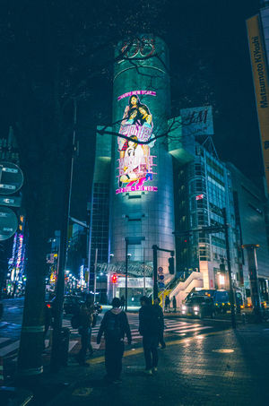EyeEm Best Shots Japan Japan Lovers Land Mark Shibuya Snapshots Of Life The Journey Is The Destination Tokyo Urban Exploration Youth Of Today Architecture Building Exterior Built Structure City Illuminated Men Midnight Night Nightlife Outdoors People Real People Shibuya109 Statue Tree Urban Life Women