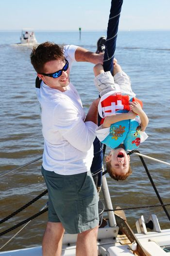 EyeEmNewHere Alabama Toddler  Boy Outdoors Father Son Nature Sailing Family Sailboat Sailing Gulf Coast Males  Men Two People Boys Father And Son Lagoon410 Sea Sailing Vessel Nautical Vessel Water Toddler  Playing Laugh laughing
