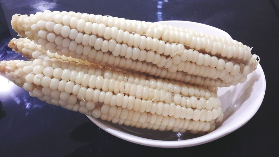 High angle view of white corn in bowl on table
