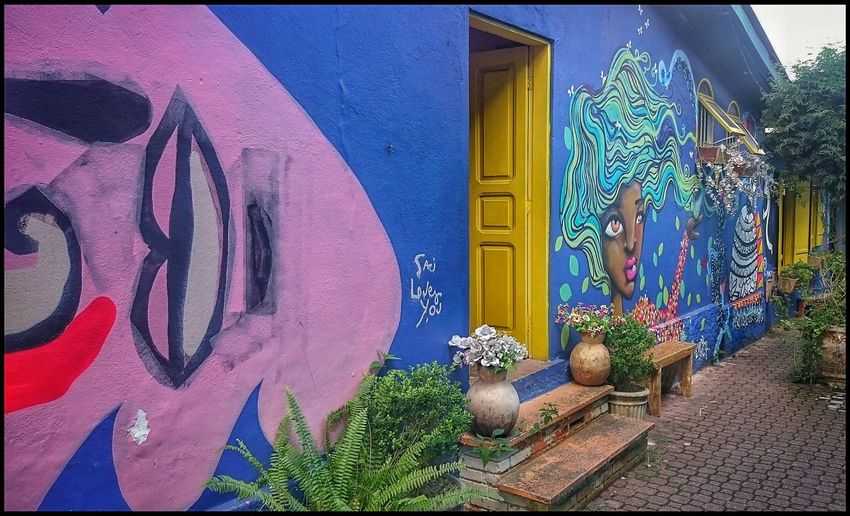 Yellow door. Street art. Hanging Out Taking Photos Check This Out Walking Around The Street Photographer - 2016 EyeEm Awards Door Yellow Door Yellow Doors From The Past EyeEm Gallery EyeEm Team Eye4photography  Photos Photography Eyeemphotography EyeEm Art Photography Sony Street Art Streetphoto_color Street Photography Streetphotography Artphotography Coloured House Open Door