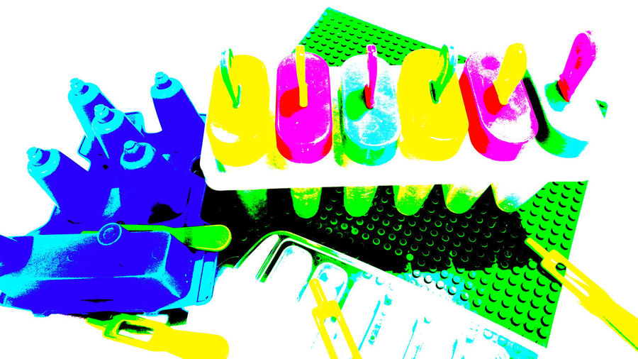 High angle view of multi colored clothespins on white background