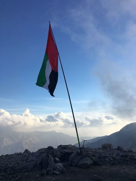 Sky Nature Tranquility Beauty In Nature Day Mountain Outdoors Tranquil Scene Scenics Low Angle View No People Cloud - Sky UAE flag