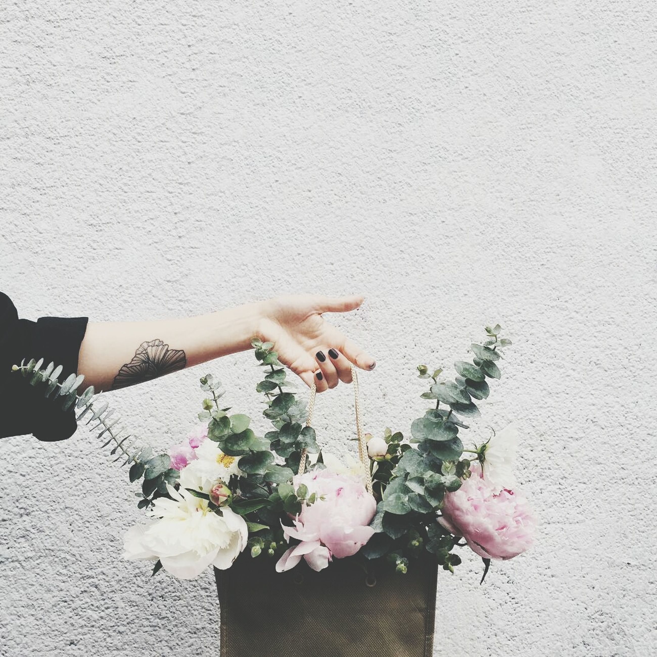flower, bouquet, bunch of flowers, freshness, wall - building feature, flower arrangement, fragility, nature, person, holding, beauty in nature, petal, vacations, pink color, blossom, flower head, collection