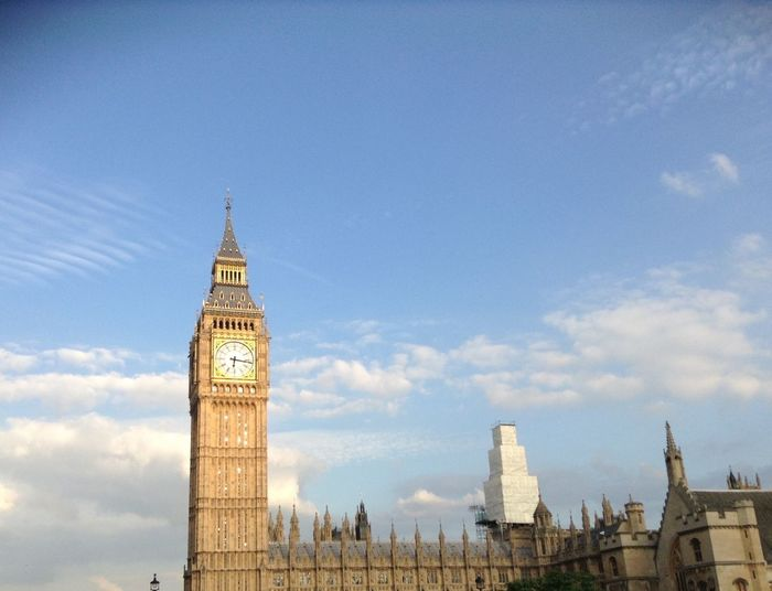 Big Ben And Palace Of Westminster In City Against Sky
