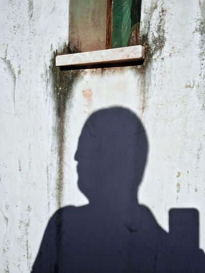 Selfie over the wall (on a sunny day you can shoot forever). Shadow And Light Shadow Leakage Portrait Selfies Self Portrait Self Shadow One Person Real People Day Sunlight Wall - Building Feature Standing Focus On Shadow Unrecognizable Person Built Structure