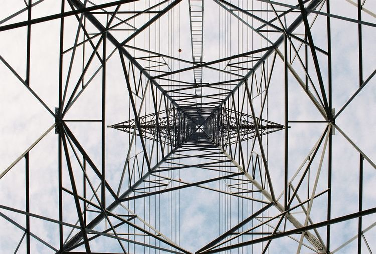 high voltage pole Girder Electricity Pylon Concentric Steel Symmetry Full Frame Electricity  Cable Pattern Below Power Line  Electric Pole Power Cable Tower Communications Tower Electrical Grid High Voltage Sign