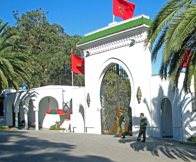 The King of Morocco's Tangier Palace - Morocco, North Africa Guards Kings Palace Moroccan Flags Moroccan Soldiers Royal Residance Architecture Building Exterior Built Structure Day Full Length Iron Gates Outdoors Palm Trees ❤❤ Real People Tangier_Morroco Tree