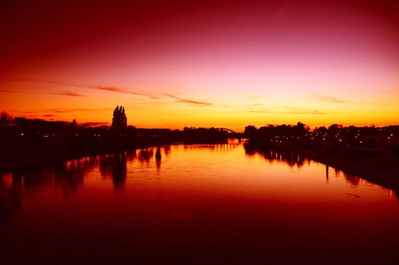 Reflection Sunset Travel Destinations Orange Color Architecture Built Structure Sky Tranquil Scene Scenics Silhouette Water Building Exterior No People Nature Beauty In Nature Outdoors Cultures
