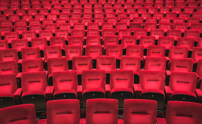 Full frame shot of empty chairs in auditorium