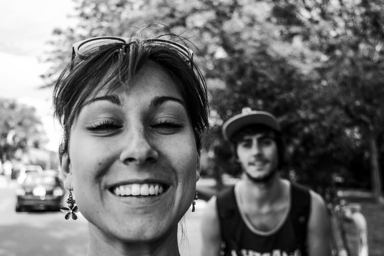 Close-up portrait of a smiling young couple