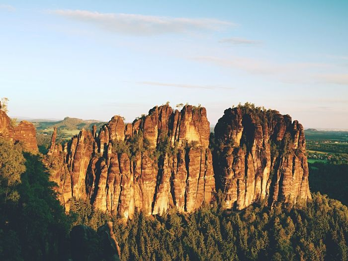 Morning sunlight on rocky towers of schrammsteine in national park saxony switzerland, germany.