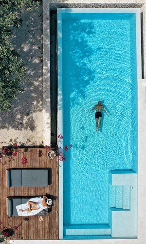 View of swimming pool by building