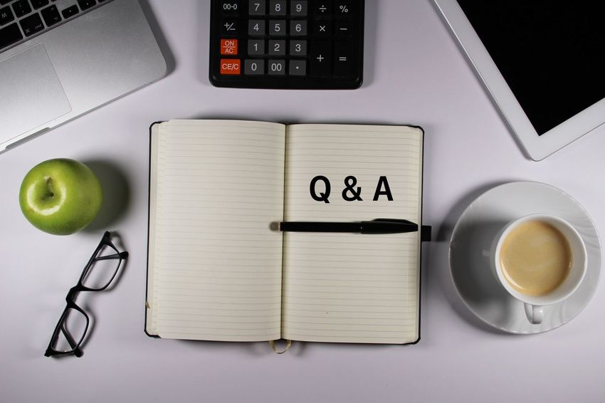 Q&A written on notebook Communication Computer Keyboard Connection Desk High Angle View Laptop Note Book Note Pad Notebook Office Pen Q&A Questions And Answers Wireless Technology