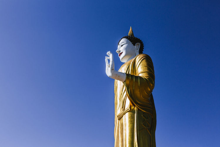 Statue Sculpture Human Representation Belief Art And Craft Spirituality Religion Male Likeness Sky Representation Blue Gold Colored Architecture Copy Space Craft Creativity Place Of Worship No People Idol Buddist Buddist Statue
