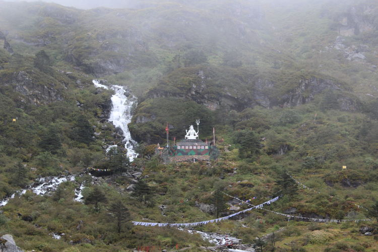 Indo-Tibet Border Faith Hinduism Lord Shiva Waterfalls And Calming Views  Beauty In Nature Day High Angle View Mountain Nature No People Outdoors Scenics Tree Waterfall #water #landscape #nature #beautiful