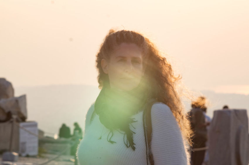 Raphaela Gilla in the sunset Portrait One Person Headshot Sky Hairstyle Architecture Nature Focus On Foreground Waist Up Long Hair Women Brown Hair Front View Young Adult Adult Sunset Day Leisure Activity Outdoors Hood - Clothing Lens Flare Contemplation Warm Clothing