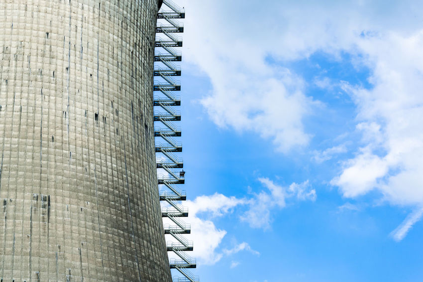 Old cooling tower against the blue sky in Hamm Uentrop Architecture Building Exterior Built Structure Cloud - Sky Cooling Tower Hamm Industry Low Angle View No People Outdoors Power Plant Sky Uentrop