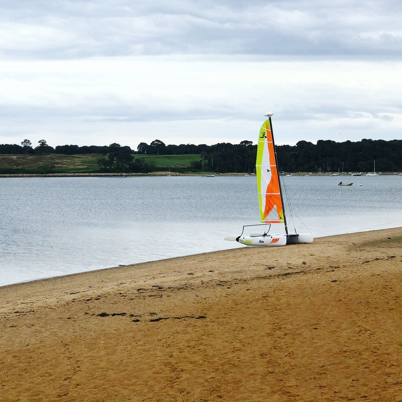 water, sky, nature, sea, cloud - sky, day, beach, land, scenics - nature, flag, beauty in nature, no people, tranquility, tranquil scene, plant, outdoors, patriotism, non-urban scene, nautical vessel, sailboat