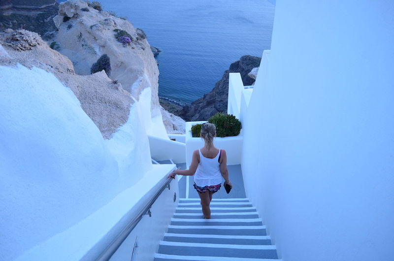 High angle view of woman on steps at santorini