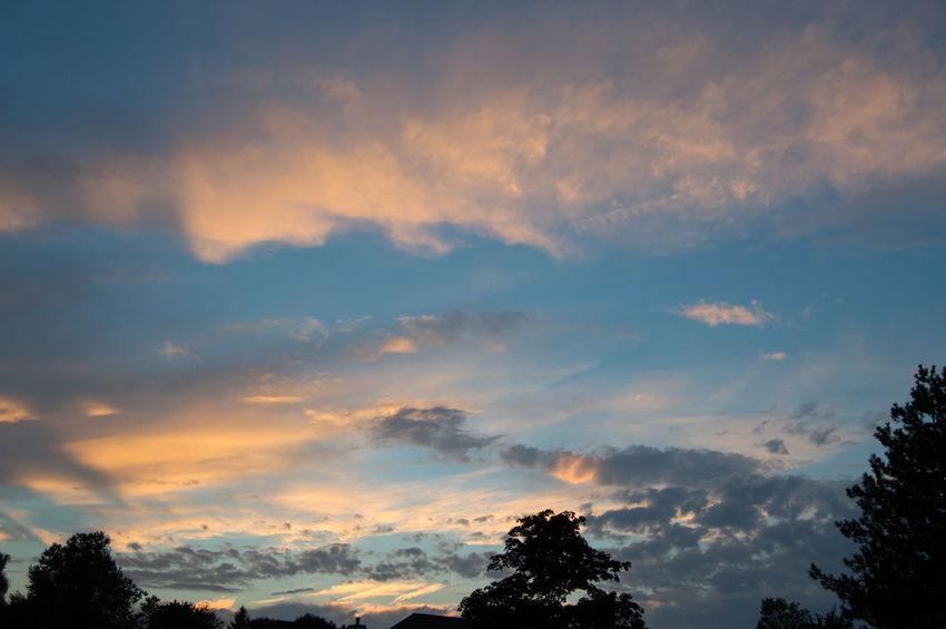 Taken at dusk in summer time. Blue Clouds Cloudscape Light Majestic Orange Color Silhouette Sunset Tranquil Scene