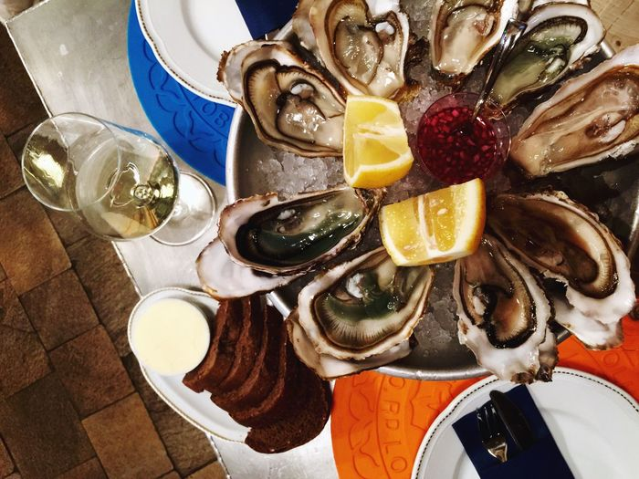 High angle view of mussel and wineglass on table