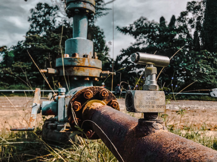 Rusty machine part on field