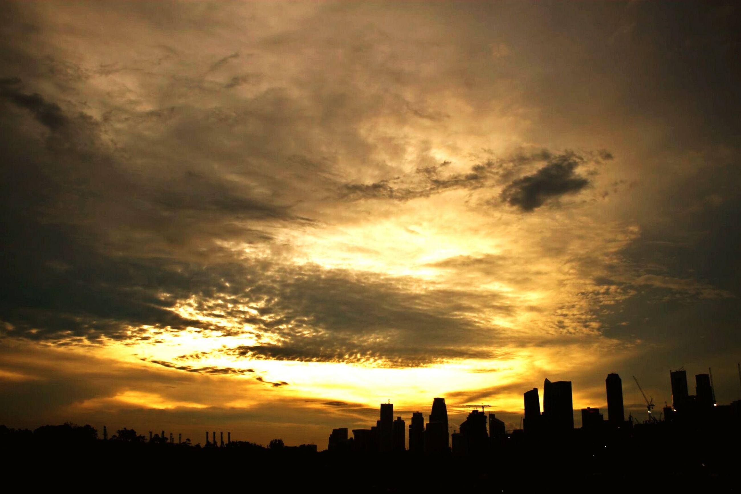 sunset, silhouette, sky, building exterior, architecture, orange color, built structure, city, cloud - sky, scenics, beauty in nature, cityscape, outline, nature, dramatic sky, cloud, skyscraper, tranquil scene, urban skyline, idyllic