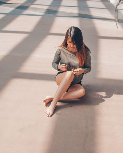 Shadow Sunlight Sitting Full Length Young Adult One Person Long Hair Women Only Women Day Outdoors Beauty Beautiful Woman Young Women One Woman Only One Young Woman Only Wireless Technology Leisure Activity Adult Smiling EyeEm Ready