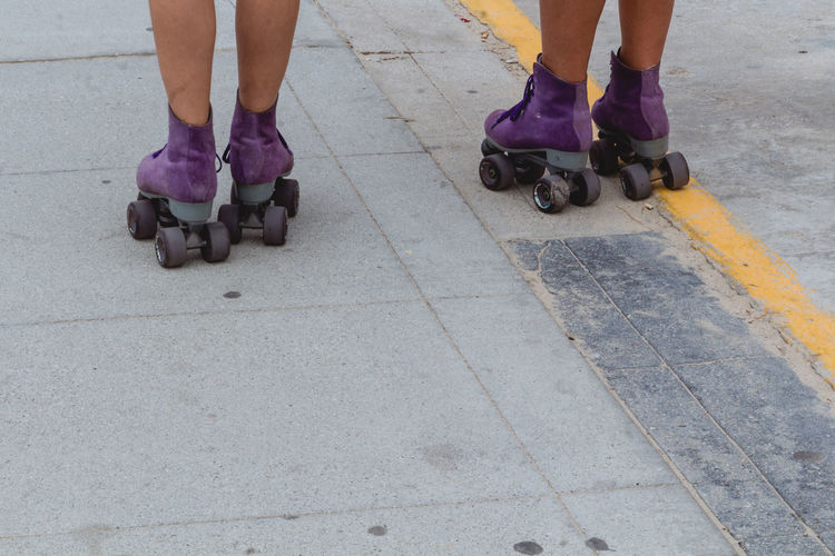 Bright purple rollerskates in Venice - IG: @LostBoyMemoirs Streetwise Photography Streetphotography Street Photography People People Watching people and places Low Section Real People Body Part Outdoors Leisure Activity Footpath Rollerskating California California Dreamin Venice Beach The Art Of Street Photography