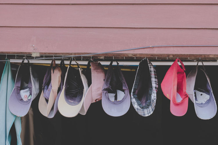 Clothes drying on clothesline against wall