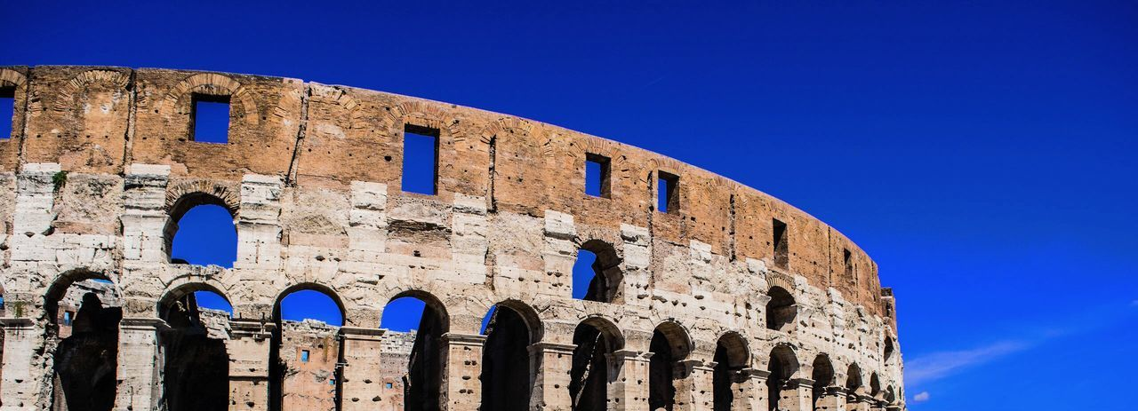 The coliseum one of the most iconic place in Rome Roman Wonder Sightseeing Landmark Colosseum Colosseo Coliseum Rome Blue Sky Built Structure Architecture Building Exterior History The Past Low Angle View No People Tourism Travel Destinations Arch Old Ruin Travel Ancient Outdoors