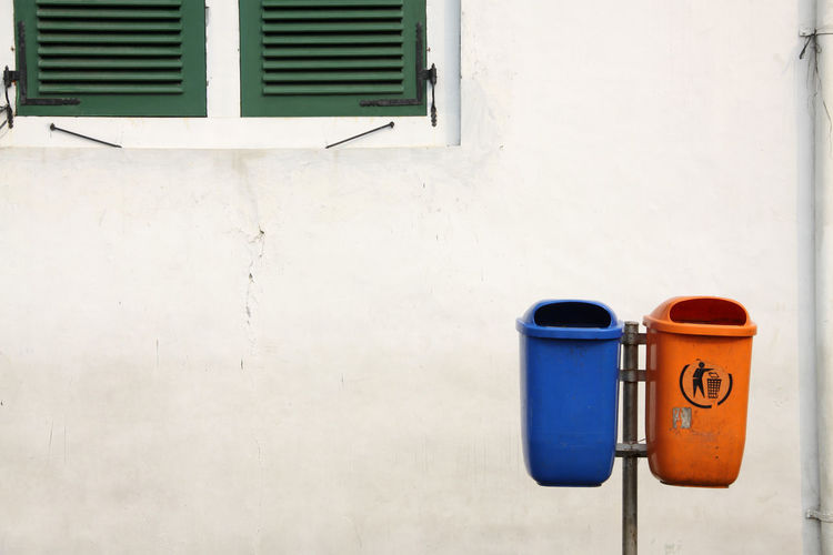 Garbage bins against wall
