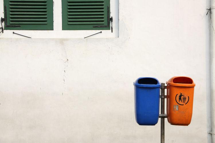 Garbage Bins Against Wall