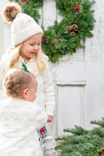Girl and christmas tree on plant
