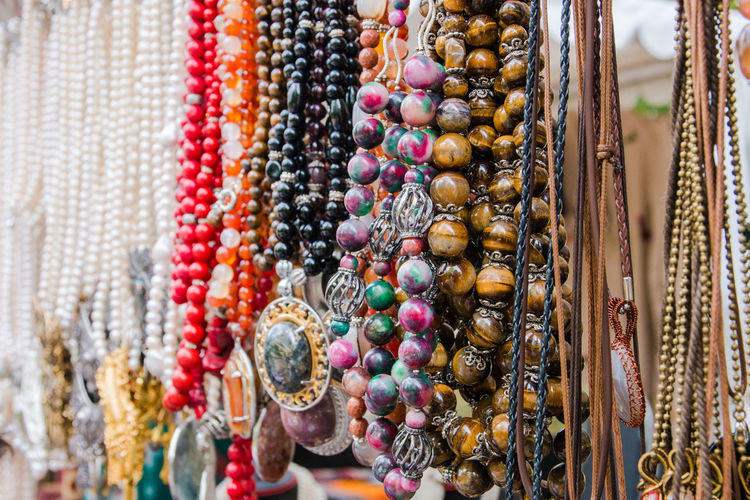 colorful beads Abundance Bead Business Choice Close-up Collection Day For Sale Hanging Jewelry Large Group Of Objects Market Market Stall Multi Colored Necklace No People Outdoors Retail  Retail Display Sale Small Business Variation