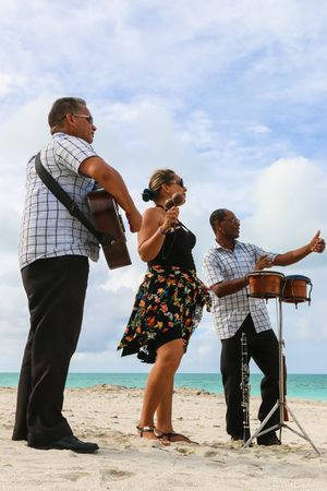 Trio ensemble performing on the beach, Cuba, Varadero Cuba. Varadero Sea Beach Nature Real People Men Sky Playing Happiness Day Trio Standing Outdoors Sand Musicians Cuba Vacations Enjoyment Togetherness Varadero Lifestyles Ensemble Full Length Musical Instrument Casual Clothing Leisure Activity Cloud - Sky