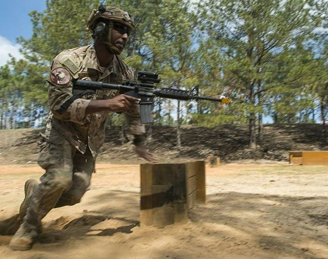 Combatcamera Airman maneuvers around a barricade during shoot and move Tactics training. Photojournalism Comcam Usafphoto USAF Airforce Miltary Reportagespotlight Found On The Roll