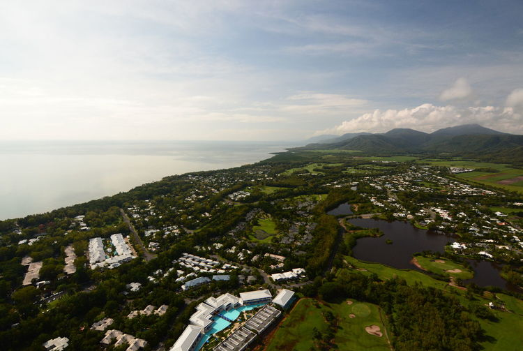 Aerial view of Port Douglas. Tropical North Queensland. Australia Scenics - Nature Nature Building Exterior Beauty In Nature Environment Aerial View Travel Destinations Outdoors Horizon Over Water Sea No People Landscape Water Sky Cloud - Sky Port Douglas Port Douglas QLD Australia Australian Landscape Town Helicopter View  Queensland Queensland Australia Cairns