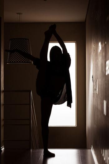 Silhouette of a dancer in her home Athlete Athletic Beautiful Dark Gymnast  Rhythmic Gymnastics SexyGirl.♥ Silhouette Silhouettes Split Woman Dancer Dancers Flexibility Girl Gymnastics Lifestyles People Portrait Rhythmic Sexygirl Shadow Stretch Stretching Window